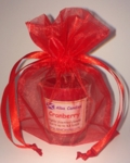 Cranberry Alba candle in a red gift bag